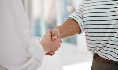 Buy stock photo Cropped shot of two unrecognizable businesswomen shaking hands together inside an office