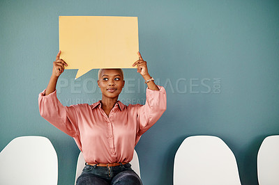 Buy stock photo Studio shot of an attractive young businesswoman looking thoughtful while holding up a speech bubble against a grey background