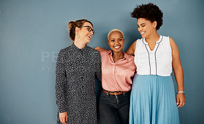 Buy stock photo Studio shot of a group of attractive young businesswomen smiling while standing together against a grey background