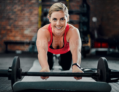 Buy stock photo Full length portrait of an attractive young female athlete doing knee roll outs in the gym