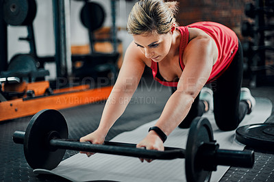 Buy stock photo Full length shot of an attractive young female athlete doing knee roll outs in the gym