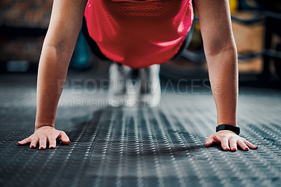 Buy stock photo Cropped shot of an unrecognizable young female athlete planking in the gym