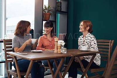Buy stock photo Cropped shot of a group of attractive middle aged women having a coffee date together as friends inside of a coffee shop during the day