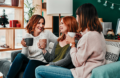 Buy stock photo Cropped shot of three attractive  middle aged women having coffee together during Christmas eve at home