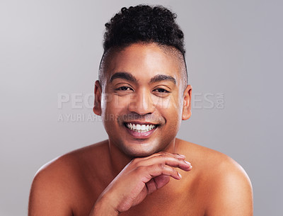 Buy stock photo Portrait of a handsome young man posing against a grey background