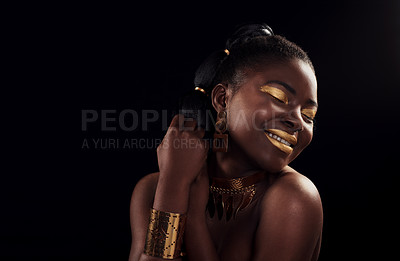 Buy stock photo Studio shot of a beautiful young woman smiling while wearing make up and jewellery against a black background
