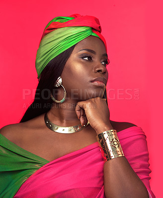 Buy stock photo Studio shot of a beautiful young woman looking thoughtful while wearing a cultural attire against a pink background