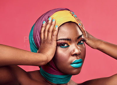 Buy stock photo Studio portrait of a beautiful young woman wearing a head wrap and make up against a pink background