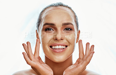 Buy stock photo Shot of a beautiful young woman wearing a face mask  against a white background