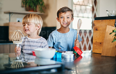 Buy stock photo Shot of two adorable little boys baking together at home