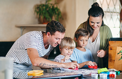Buy stock photo Shot of a young family of four baking at home