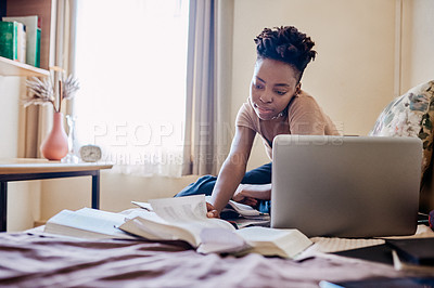 Buy stock photo Shot of an attractive young female university student studying for an exam in her room