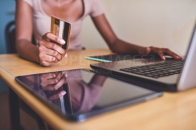 Buy stock photo Cropped shot of an unrecognizable female university student using a credit card and a laptop to shop online in her room