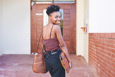 Buy stock photo Cropped portrait of an attractive young female university student smiling while going into her residence during the day