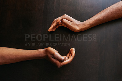 Buy stock photo High angle shot of two unrecognizable people about to hold hands over a table