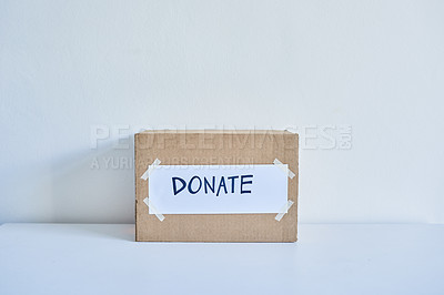 Buy stock photo Shot of a cardboard box with a sticker on it saying