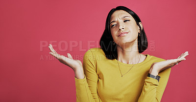 Buy stock photo Cropped shot of an attractive young woman shrugging and looking confused while standing against a pink studio background alone