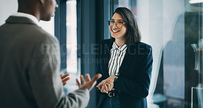 Buy stock photo Shot of a young businesswoman having a discussion with a colleague in an office