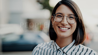 Buy stock photo Portrait of an attractive young businesswoman feeling confident and cheerful while outdoors in the city