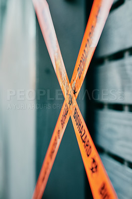 Buy stock photo Shot of barrier tape cordoning off a gate