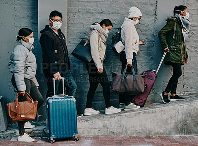 Buy stock photo Shot of a group of young people wearing masks while travelling in a foreign city