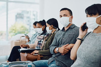 Buy stock photo Shot of a group of young people wearing masks in a waiting room