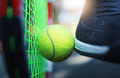 Buy stock photo Closeup shot of an unrecognizable tennis player kicking a tennis ball against a racket on a tennis court outdoors