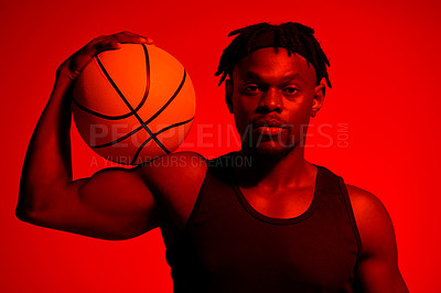 Buy stock photo Red filtered shot of a young sportsman posing with a basketball in the studio
