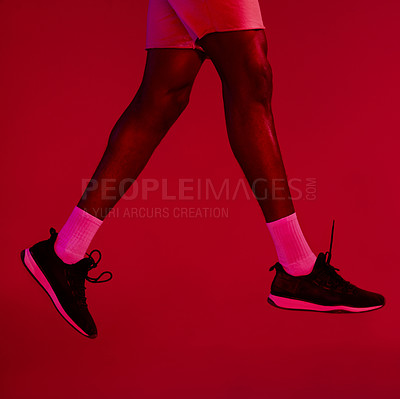 Buy stock photo Re filtered shot of an unrecognizable man wearing his workout sneakers