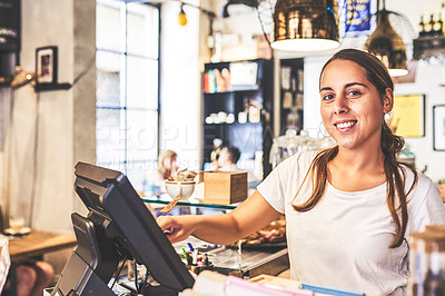 Buy stock photo Portrait of a cheerful young woman working behind a cash register inside of a coffee shop during the day
