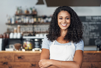 Buy stock photo Cropped shot of a young shop owner looking happy while standing in her cafe