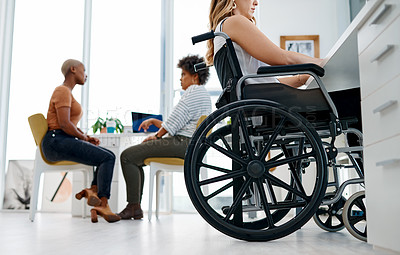 Buy stock photo Shot of a woman in a wheelchair working in a coworking space