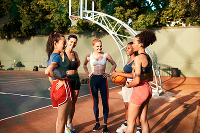 Buy stock photo Cropped shot of a diverse group of friends getting ready to play a game of basketball together during the day