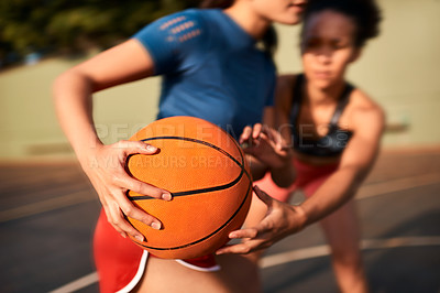 Buy stock photo Cropped shot of an unrecognizable sportswoman holding the basketball away from her opponent during the game