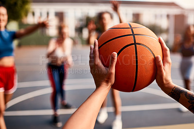 Buy stock photo Cropped shot of an unrecognizable sportswoman holding a basketball during a match with her friends