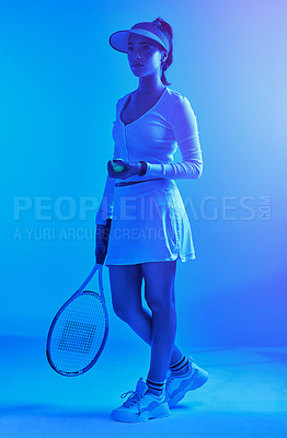 Buy stock photo Full length shot of an attractive young female tennis player posing against a blue background