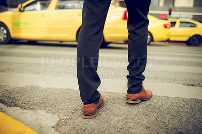 Buy stock photo Closeup shot of an unrecognisable businessman walking across a road in the city