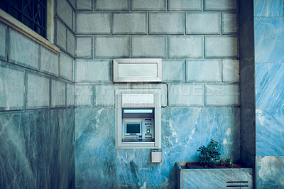 Buy stock photo Still life shot of a built-in ATM in a wall outdoors
