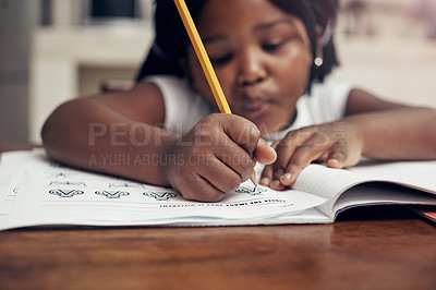 Buy stock photo Cropped shot of an adorable little girl drawing in her drawing book at home
