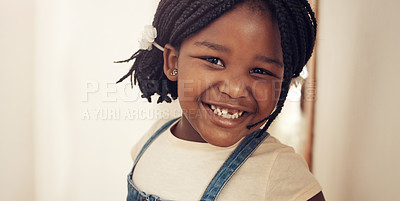 Buy stock photo Portrait of an adorable little girl feeling cheerful and happy at home