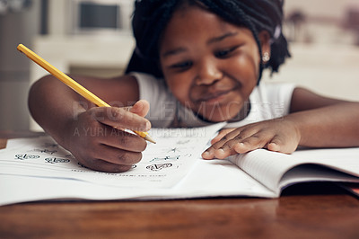 Buy stock photo Cropped shot of an adorable little girl drawing and doing her homework at home
