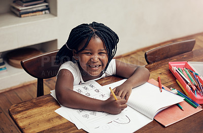 Buy stock photo Portrait of an adorable little girl drawing and doing her homework at home