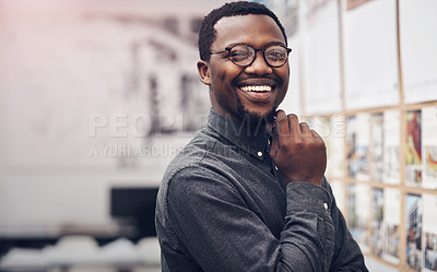 Buy stock photo Cropped portrait of a handsome young male architect smiling while standing in a modern office