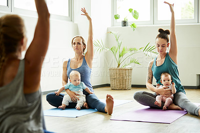 Buy stock photo Cropped shot of two attractive young mothers sitting with their babies during a baby yoga class indoors