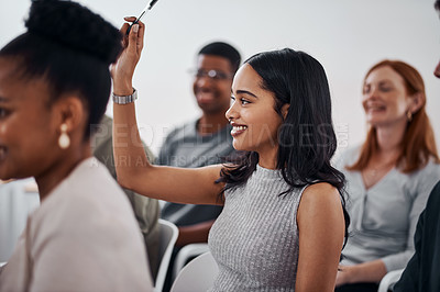 Buy stock photo Shot of a young businesswoman raising her hand during a conference
