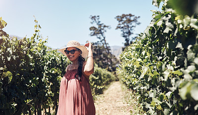 Buy stock photo Cropped shot of a happy young woman walking through a vineyard on a sunny day