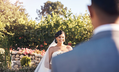 Buy stock photo Cropped shot of a happy bride looking at her groom