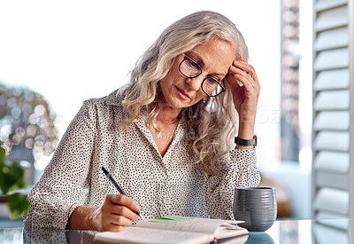 Buy stock photo Cropped shot of an attractive senior businesswoman suffering with a headache while working from home