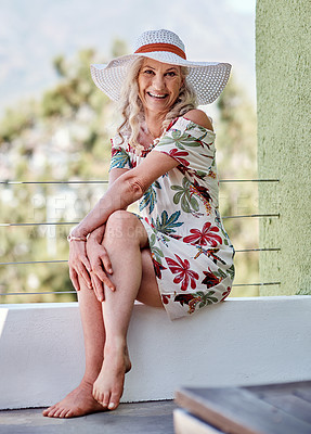 Buy stock photo Full length portrait of an attractive senior woman smiling while sitting outdoors on a summer's day