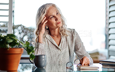 Buy stock photo Cropped shot of an attractive senior businesswoman looking thoughtful while working from home